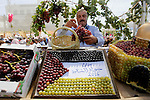 A Palestinian man displays Grapes, during the Palestinian grapes festival in Halhoul village, near the West Bank city of Hebron, on Sept. 19, 2016. Hebron is very famous in grape production as it contains many fields of grapes, the summer is the season of harvesting. Photo by Wisam Hashlamoun