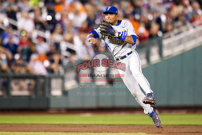 Florida Gators shortstop Richie Martin (12) makes a throw to first base during the NCAA College baseball World Series against the Virginia Cavaliers on June 15, 2015 at TD Ameritrade Park in Omaha, Nebraska. Virginia defeated Florida 1-0. (Andrew Woolley/Four Seam Images)