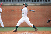 Luke Gibbs (12) of the Charlotte 49ers follows through on his swing against the Akron Zips at Hayes Stadium on February 22, 2015 in Charlotte, North Carolina.  The Zips defeated the 49ers 5-4.  (Brian Westerholt/Four Seam Images)