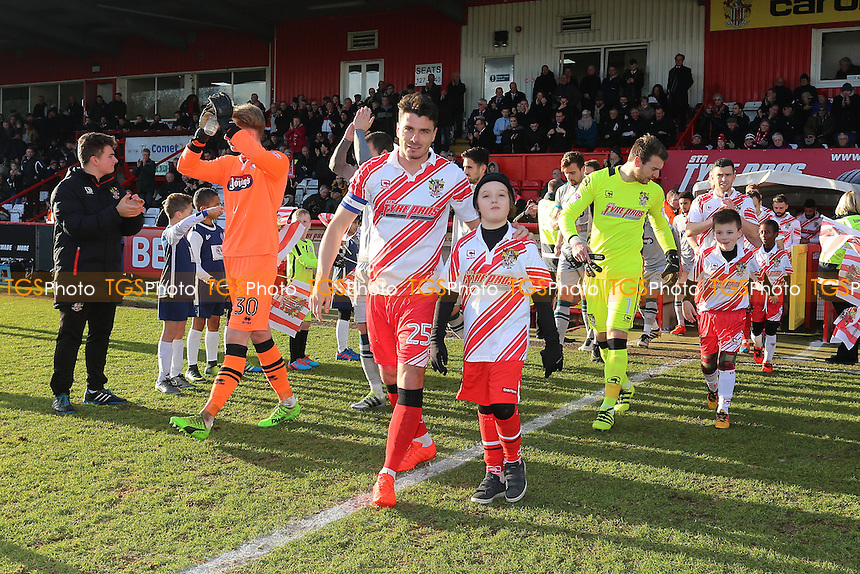 The teams take to the field during Stevenage vs Grimsby Town, Sky Bet EFL League 2 Football at the Lamex Stadium on 28th January 2017