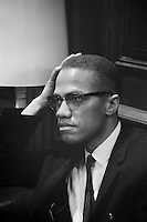 March 26, 1964-TITLE: [Malcolm X waits at Martin Luther King press conference, head-and-shoulders portrait]