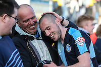 Michael Harriman of Wycombe Wanderers (right) celebrates scroring the winning goal after the Sky Bet League 2 match between Wycombe Wanderers and Mansfield Town at Adams Park, High Wycombe, England on 25 March 2016. Photo by David Horn.