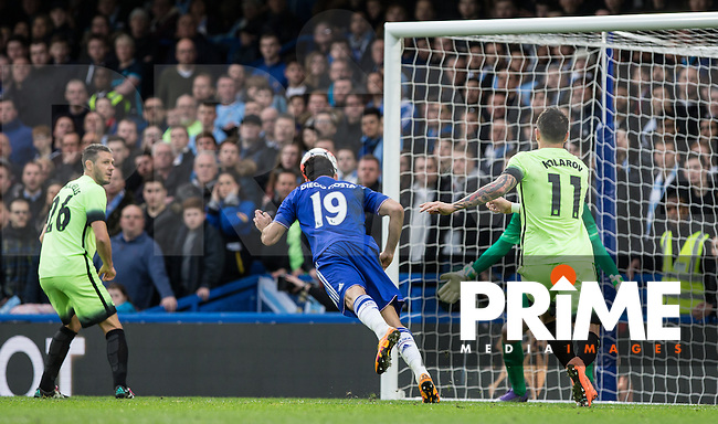 Diego Costa of Chelsea scores the first goal of the match with a diving header past Goalkeeper Wilfredo Caballero of Man City during the FA Cup 5th round match between Chelsea and Manchester City at Stamford Bridge, London, England on 21 February 2016. Photo by Andy Rowland.
