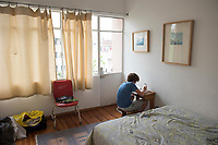 Felix doing homework in his new room. Family adapting to new surroundings after having to move post-earthquake from our damaged apartment to one we soold the day before the earthquake struck. Medellin, Roma Sur, CDMX