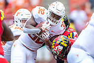 Landover, MD - September 1, 2018: Texas Longhorns running back Daniel Young (32) runs the football during game between Maryland and No. 23 ranked Texas at FedEx Field in Landover, MD. The Terrapins upset the Longhorns in back to back season openers with a 34-29 win. (Photo by Phillip Peters/Media Images International)