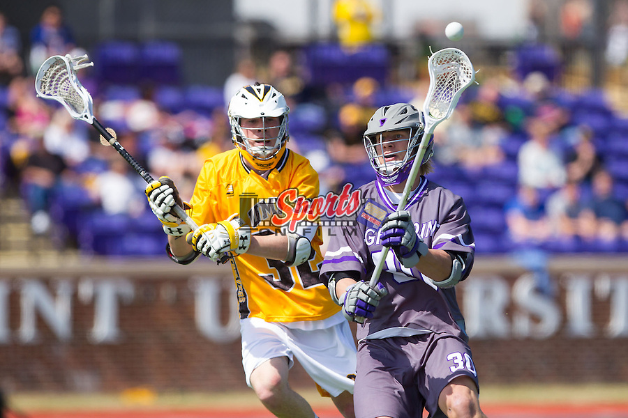 Tyler Cook (30) of the High Point Panthers passes the ball while being defended by Steve Winsor (32) of the UMBC Retrievers at Vert Track, Soccer & Lacrosse Stadium on March 15, 2014 in High Point, North Carolina.  The Panthers defeated the Retrievers 17-15.   (Brian Westerholt/Sports On Film)