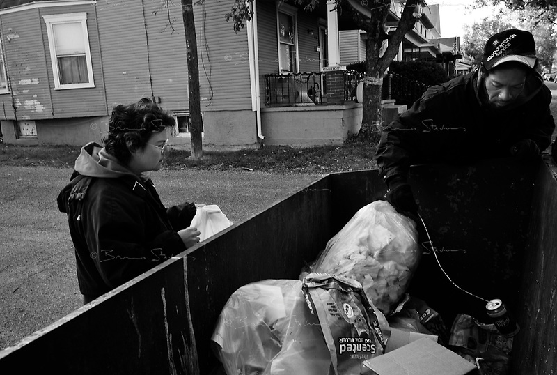 "Dayton, OH, October 29, 2008.Carlos, 40, and his girlfriend Karen, 38, pick up soda cans from garbage bins and make about 150$ a month selling them to a metal recycling company; they also share Karen' social security monthly allowance; they have voted for McCain, because ""he will make things better""."