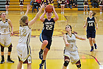 02/08/13--Liberty Falcons' Hannah Langbehn (22) shoots over Milwaukie Mustangs Emily Downs (12) after being fouled by Mustangs' Lorissa Martine (3) in the second half at Milwaukie High School..Photo by Jaime Valdez ..