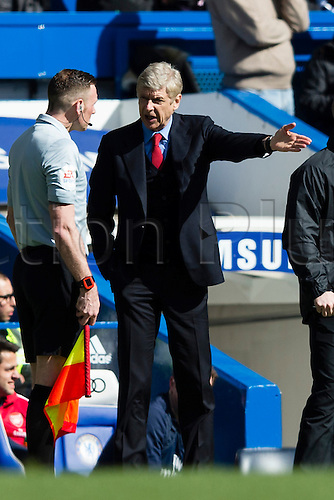 22.03.2014  London, England.  Arsenal Manager Arsene WENGER complains to the fourth official about the Kieran GIBBS (not pictured) sending off incident during the Premier League game between Chelsea and Arsenal from Stamford Bridge.
