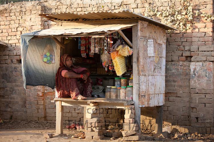 Indian woman stallholder selling sweets and toys at Sarnath near Varanasi, Benares, Northern India