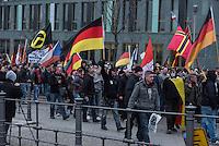 """Etwa 2.000 rechtsradikale Menschen demonstrierten am Samstag den 12. Maerz 2016 in Berlin unter dem Motto """"Merkel muss weg!"""" gegen Angela Merkel, gegen Fluechtlinge und fuer """"Das deutsche Vaterland"""".<br /> Bis auf wenige Ausnahmen waren angereisten Teilnehmer Neonazis und Hooligans, NPD-, Pediga- und AfD-Mitglieder.<br /> Aufgerufen zu dem Aufmarsch hatten die Hooligan-Gruppen """"Buendnis fuer Deutschland"""" und """"Buendnis fuer Berlin"""".<br /> 12.3.2016, Berlin<br /> Copyright: Christian-Ditsch.de<br /> [Inhaltsveraendernde Manipulation des Fotos nur nach ausdruecklicher Genehmigung des Fotografen. Vereinbarungen ueber Abtretung von Persoenlichkeitsrechten/Model Release der abgebildeten Person/Personen liegen nicht vor. NO MODEL RELEASE! Nur fuer Redaktionelle Zwecke. Don't publish without copyright Christian-Ditsch.de, Veroeffentlichung nur mit Fotografennennung, sowie gegen Honorar, MwSt. und Beleg. Konto: I N G - D i B a, IBAN DE58500105175400192269, BIC INGDDEFFXXX, Kontakt: post@christian-ditsch.de<br /> Bei der Bearbeitung der Dateiinformationen darf die Urheberkennzeichnung in den EXIF- und  IPTC-Daten nicht entfernt werden, diese sind in digitalen Medien nach §95c UrhG rechtlich geschuetzt. Der Urhebervermerk wird gemaess §13 UrhG verlangt.]"""