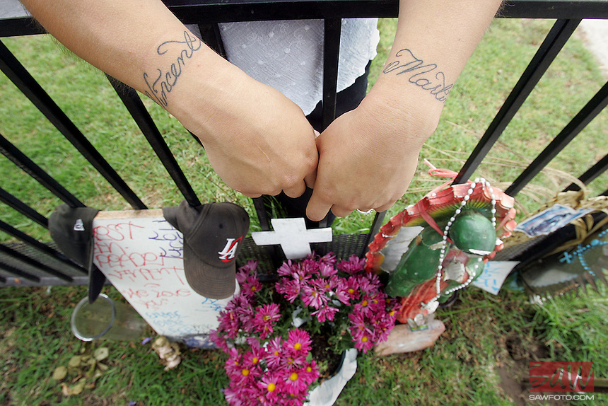 DETAIL of tattoo on arms of Christina Bojorquez, (cq)18. Bojorquez, girlfriend of murdered teenager Vincent Martinez at site in front of her home where her boyfriend was shot dead. Bojorquez is pregnant with Vincent's child. Grieving Oxnard mother Marisa Martinez is offers a reward to find the killers of her 19-year-old son,Vincent. Vincent would have turned 20 later this month. He was gunned down four months ago in front of his home, leaving behind a broken family and pregnant girlfriend. Unwilling to let this fade into just another Oxnard murder, Marisa Martinez has collected a reward and won't rest til she finds Vincent's killer.