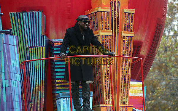 KANYE WEST.The 84th Annual Macy's Thanksgiving Day Parade on November 25, 2010 in New York City, NY, USA..November 25th, 2010.full length black coat jacket sunglasses shades headband.CAP/ADM/PZ.©Paul Zimmerman/AdMedia/Capital Pictures.
