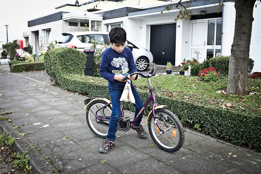 GERMANY, Pulheim: Youssef on his bike nearby his house. As refugees, they got help from government but also from some volunteers giving toys and clothes to refugees.