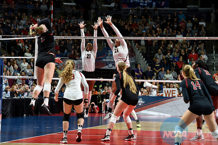 COLUMBUS, OH - DECEMBER 17:  Chloe Collins (21) and Yaazie Bedart-Ghani (27) of the University of Texas jump for a block against Stanford University during the Division I Women's Volleyball Championship held at Nationwide Arena on December 17, 2016 in Columbus, Ohio.  Stanford defeated Texas 3-1 to win the national title. (Photo by Jamie Schwaberow/NCAA Photos via Getty Images)