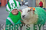 WOOLLY PET: Jack Roche, Castleisland, with his sheep at the Castleisland St Patricks Day Parade..