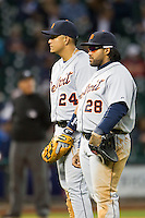 Detroit Tigers third baseman Miguel Cabrera (24) and first baseman Prince Fielder (28) look on during a pitching change in the MLB baseball game against the Houston Astros on May 3, 2013 at Minute Maid Park in Houston, Texas. Detroit defeated Houston 4-3. (Andrew Woolley/Four Seam Images).
