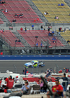 Oct. 11, 2009; Fontana, CA, USA; NASCAR Sprint Cup Series driver Jimmie Johnson races in front of nearly empty grandstands during the Pepsi 500 at Auto Club Speedway. Mandatory Credit: Mark J. Rebilas-