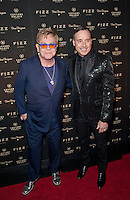 LAS VEGAS, NV - March 28: Elton John & David Furnish pictured arriving at FIZZ Grand Openign at Caesars Palace in Las Vegas, NV on March 28, 2014. © Kabik/ Starlitepics
