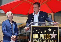 LOS ANGELES, CA. July 15, 2016: Singer Pitbull (Armando Christian Perez) with motivational speaker Tony Robbins on Hollywood Blvd where Pitbull was honored with the 2,584th star on the Hollywood Walk of Fame.<br /> Picture: Paul Smith / Featureflash
