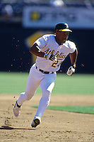 OAKLAND, CA - Rickey Henderson of the Oakland Athletics runs the bases during a game at the Oakland Coliseum in Oakland, California in 1998. Photo by Brad Mangin