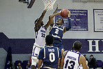 HIGH POINT, NC - JANUARY 06: Charleston Southern's Cortez Mitchell (2) and High Point's Andre Fox (22). The High Point University of Panthers hosted the Charleston Southern University Buccaneers on January 6, 2018 at Millis Athletic Convocation Center in High Point, NC in a Division I men's college basketball game. HPU won the game 80-59.