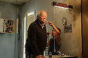 London, UK. 02.06.2015. Dudley Sutton and Mitchell Jelley rehearse HAVE YOUR CIRCUMSTANCES CHANGED? in the former FADS shop, Archway. Photograph © Jane Hobson.