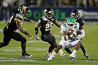 1 September 2011:  FIU defensive back Richard Leonard (3), with linebacker Jordan Hunt (25) and defensive line James Jones (94) in pursuit, tackles North Texas wide receiver Michael Outlaw (82) in the second half as the FIU Golden Panthers defeated the University of North Texas, 41-16, at University Park Stadium in Miami, Florida.