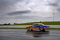 May 19, 2017; Topeka, KS, USA; NHRA stock eliminator driver Tim Nicholson drives to the pits during a rain delay to qualifying for the Heartland Nationals at Heartland Park Topeka. Mandatory Credit: Mark J. Rebilas-USA TODAY Sports