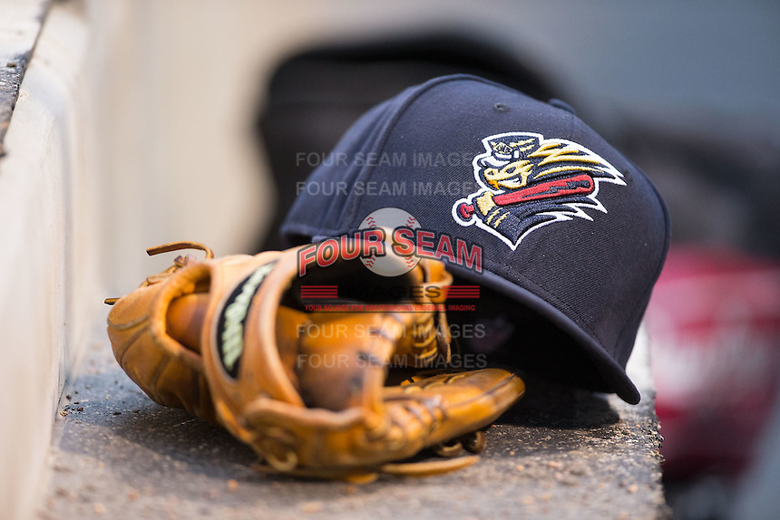 A Scranton\Wilkes-Barre RailRiders cap sits on top of a glove in the visitors dugout during the game against the Charlotte Knights at BB&T BallPark on May 1, 2015 in Charlotte, North Carolina.  The RailRiders defeated the Knights 5-4.  (Brian Westerholt/Four Seam Images)