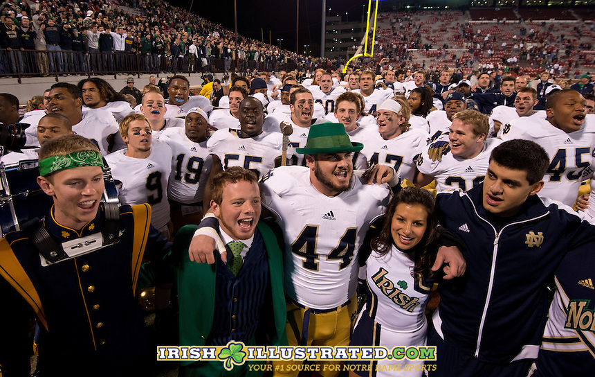 Linebacker Carlo Calabrese (44) sings the alma mater with the Notre Dame leprechaun.