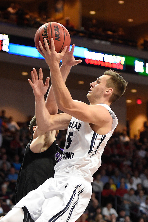 March 9, 2015; Las Vegas, NV, USA; Brigham Young Cougars guard Kyle Collinsworth (5) shoots a layup against the Portland Pilots during the first half of the WCC Basketball Championships at Orleans Arena.