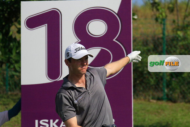 Michael Hoey (NIR) tees off on the 18th tee during Saturday's storm delayed conclusion of Round 2 of the Iskandar Johor Open 2011 at the Horizon Hills Golf Resort Johor, Malaysia, 19th November 2011 (Photo Eoin Clarke/www.golffile.ie)