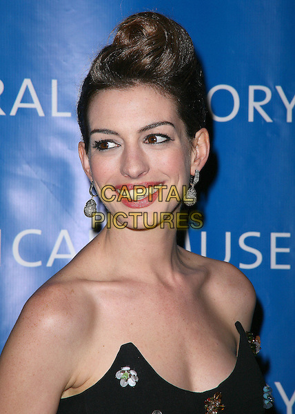 ANNE HATHAWAY.The American Museum of Natural History's 2010 Museum Gala at the American Museum of Natural History, New York City, NY, USA..November 18th, 2010.headshot portrait black strapless hair up coif dangling silver earrings balls smiling.CAP/ADM/PZ.©Paul Zimmerman/AdMedia/Capital Pictures.