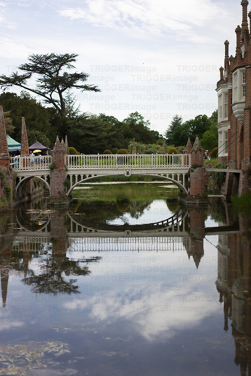 Helmingham Hall gardens in Suffolk England. With draw bridge over moat.