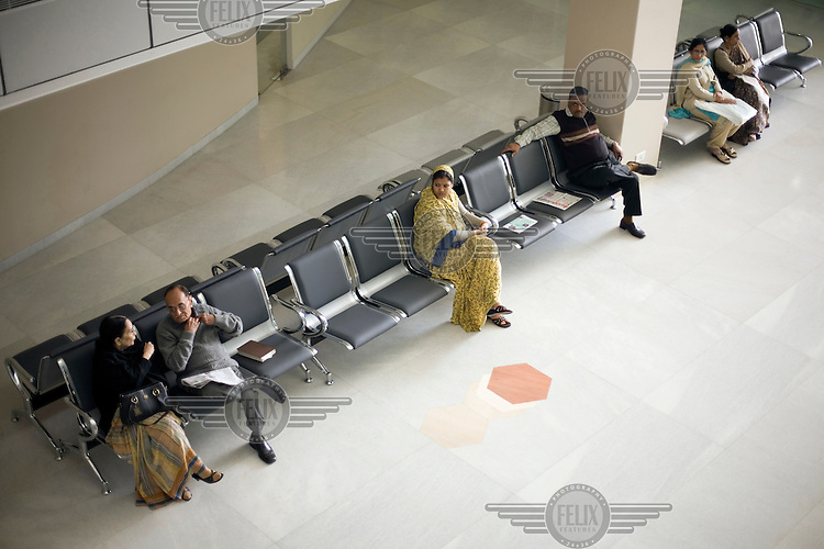 Patients wait in a waiting area at Medanta - The Medicity, near New Delhi. The hospital is India's most technologically advanced multi-disciplinary hospital, founded by leading cardiac surgeon Dr Naresh Trehan.