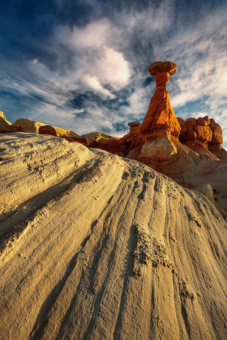 A hoodoo glows in southwest Utah as the rising sun casts a warm light on the sandstone below.