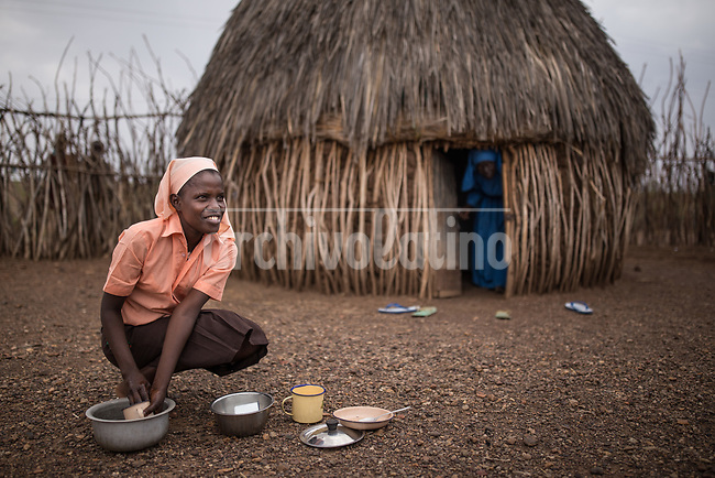 A woman in a hut  in Kakuma refugee camp in Kenya.Kakuma refugee camp in North of Kenya. Kakuma is the site of a UNHCR refugee camp, established in 1991. The population of Kakuma town was 60,000 in 2014, having grown from around 8,000 in 1990. In 1991, the camp was established to host the 12,000 unaccompanied minors who had fled the war in Sudan and came walking from camps in Ethiopia.