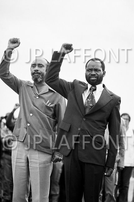 26 Jun 1975, Mozambique --- Samora Machel, commander-in-chief of the Front for the Liberation of Mozambique (FRELIMO). He became independent Mozambique's first president on June 25, 1975. On his left, new Vice-President Marcelino dos Santos. | Location: Lourenco Marques, Mozambique. --- Image by © JP Laffont