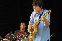 Guitarist and lead vocalist Ezra Koenig and drummer Chris Tomson of Brooklyn NY based indie alt rockers Vampire Weekend perform at Summer Stage in Central Park NYC ( June 14, 2008)