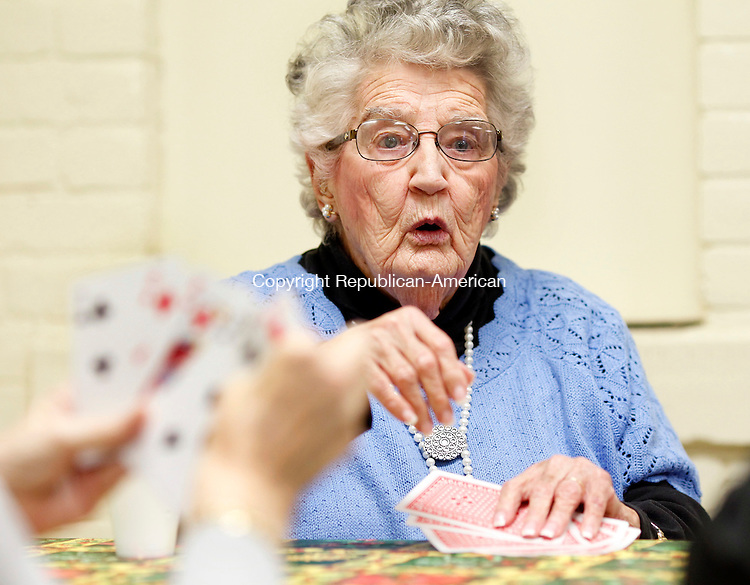 Naugatuck, CT-04 January 2013-010413CM01-  Joan Wagner of Naugatuck, plays the card game Setback with a group of friends Friday afternoon at the Naugatuck Senior Center.  Wagner's game partner was Kathryn Richards, and two played against Rose Douty and Shirley Cummings.  The Setback Club, which was started by Robert Greene is seeking more members.  For more information or if anyone is interested please contact the Senior Center at (203) 720-7069.       Christopher Massa Republican-American