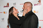 WWE Chief Brand Officer Stephanie McMahon and WWE Superstar Triple H Prepare To Share A Kiss At The World Premiere of Scooby Doo! WrestleMania Mystery Held at Tribeca Cinemas, NY