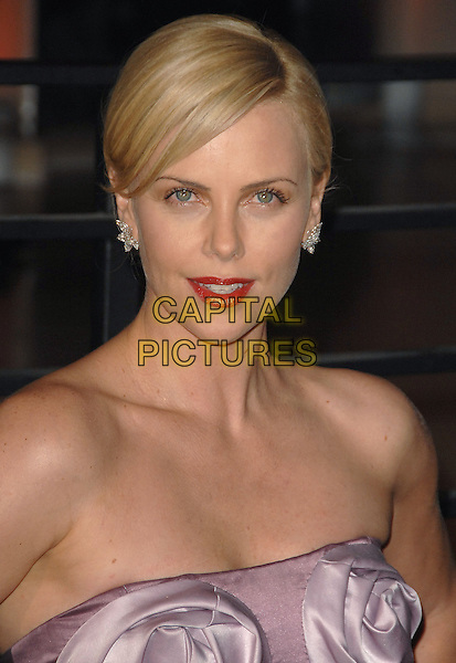 CHARLIZE THERON.The 2010 Vanity Fair Oscar Party held at The Sunset Tower Hotel in West Hollywood, California, USA..March 7th, 2010.oscars headshot portrait pink two tone bustier bodice couture red lipstick silk satin strapless .CAP/RKE/DVS.©DVS/RockinExposures/Capital Pictures.