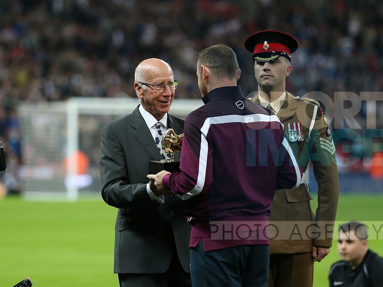 England's Wayne Rooney gets presented with a golden boot by Sir Bobby Charlton<br /> <br /> Euro 2016 Qualifier- England vs Estonia - Wembley Stadium - England - 9th October 2015 - Picture David Klein/Sportimage