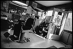 Interior of Mr. Green's Barber Shop. The shop has been at this location for almost 70 years and Mr. Green has owned it for 37. It provides a place for conversation for many of the neighborhood men, several of whom live in halfway houses within a few blocks of the shop.