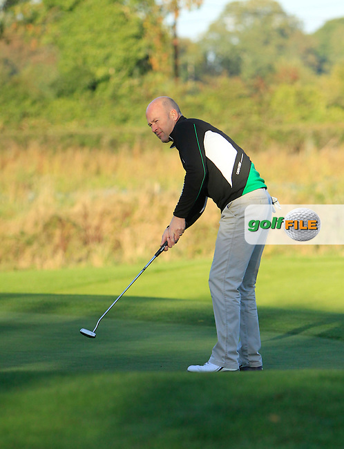 Jimmy Bolger (Kilkenny G.C) on the 8th green during Round 1 of The Cassidy Golf 103rd Irish PGA Championship in Roganstown Golf Club on Thursday 10th October 2013.<br /> Picture:  Thos Caffrey / www.golffile.ie