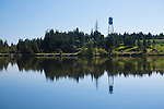 Idaho, North Central, Winchester.  The iconic water tower  at Winchester Lake in evening light at Winchester Lake State Park.