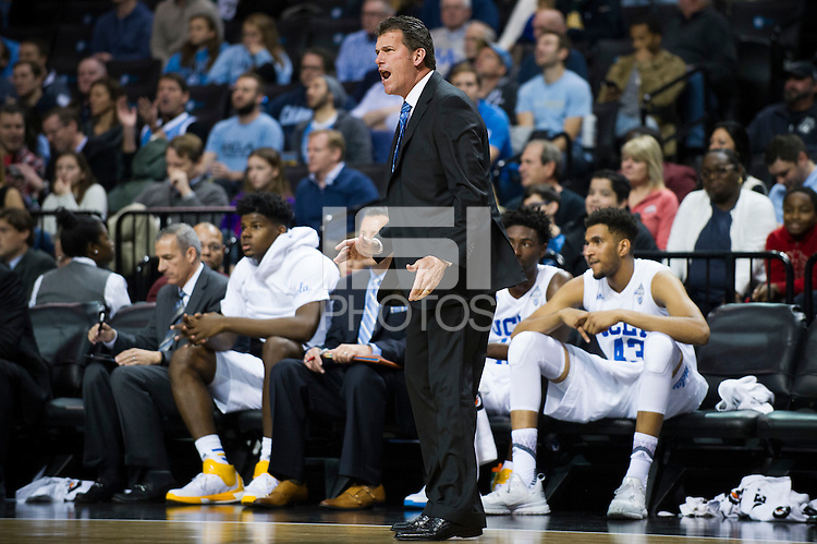 BROOKLYN, NY - Saturday December 19, 2015: UCLA Men's Basketball Head Coach Steve Alford gives his team direction against the North Carolina Tar Heels as the two square off in the CBS Classic at Barclays Center in Brooklyn, NY.