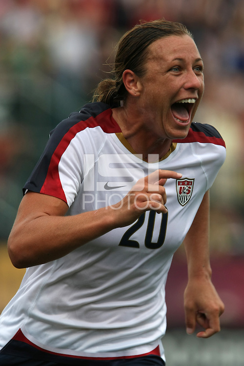 USWNT's Abby Wambach (20) celebrates after scoring her 100th career goal in the second half. The U.S. Women's National Team defeated Canada 1-0 in a friendly match at Marina Auto Stadium in Rochester, NY on July 19, 2009.