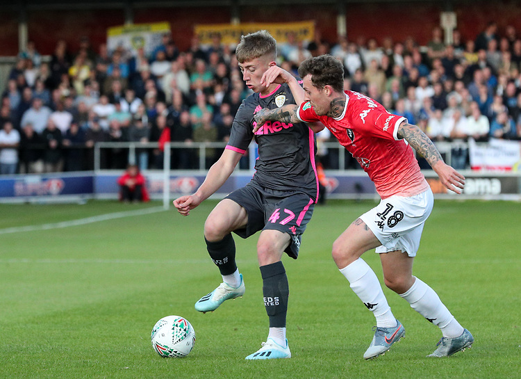Leeds United's Jack Clarke battles with Salford City's Danny Whitehead<br /> <br /> Photographer Alex Dodd/CameraSport<br /> <br /> The Carabao Cup First Round - Salford City v Leeds United - Tuesday 13th August 2019 - Moor Lane - Salford<br />  <br /> World Copyright © 2019 CameraSport. All rights reserved. 43 Linden Ave. Countesthorpe. Leicester. England. LE8 5PG - Tel: +44 (0) 116 277 4147 - admin@camerasport.com - www.camerasport.com